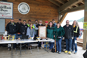 Kensington employees and the Gold Rush Days Committee pose with the poster from the very first Gold Rush Days.